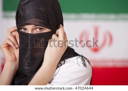 muslim woman in front of iran flag - stock photo