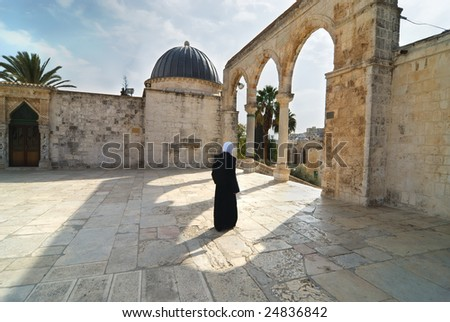 Muslim woman leaving the yard of the Dome of the rock in Jerusalem - stock photo