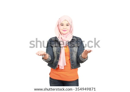 muslim woman measuring something on the palms of her hands - stock photo