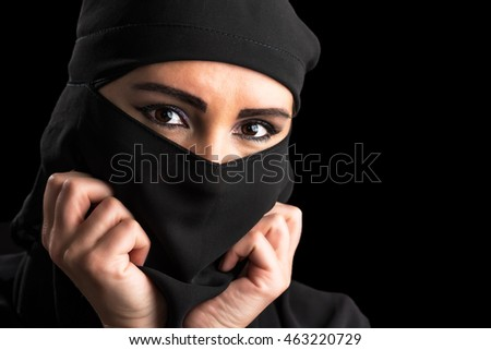 Muslim woman portrait isolated on black background