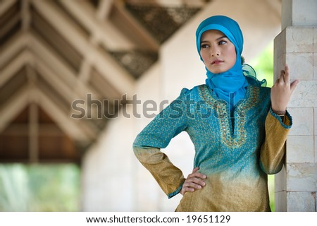 muslim woman posing in mosque - stock photo
