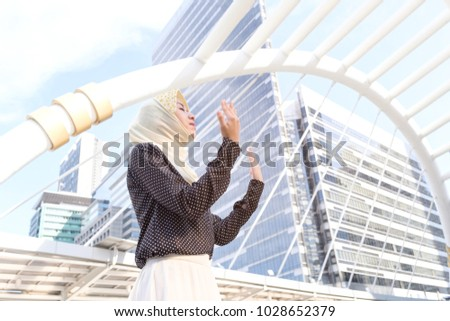 Muslim woman praying in building city, Portrait of Muslim people concept