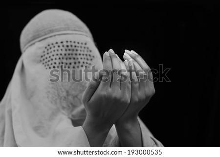 Muslim woman praying on traditional way  - stock photo