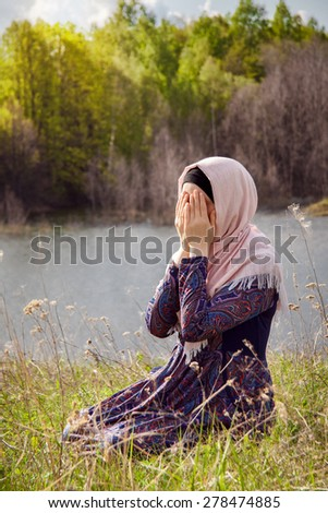 Muslim Woman Reading Holy Quran - stock photo