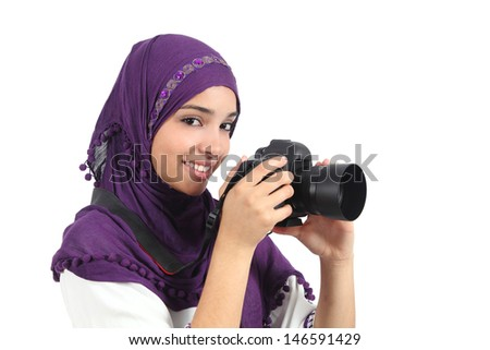 Muslim woman taking a photography with a slr camera isolated on a white background          - stock photo