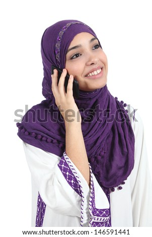 Muslim woman talking on the phone isolated on a white background               - stock photo
