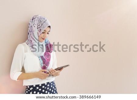 muslim woman use tablet - stock photo