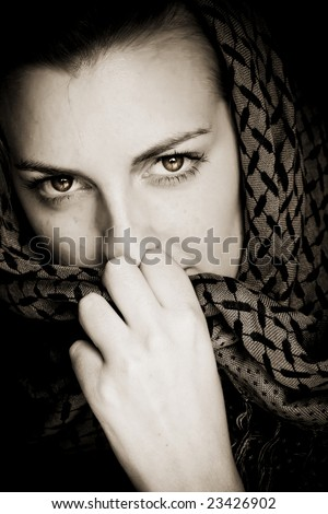 Muslim woman with her face covered. - stock photo