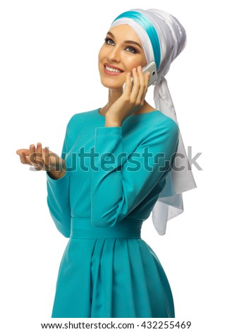 Muslim woman with mobile phone isolated - stock photo