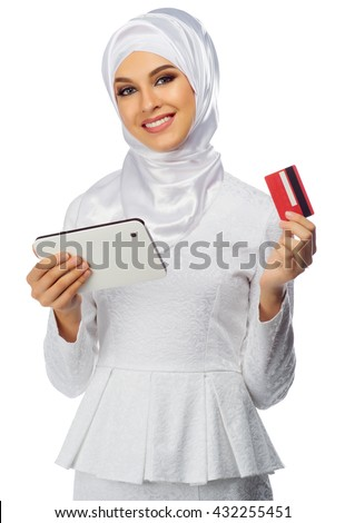 Muslim woman with tablet PC and credit card isolated - stock photo