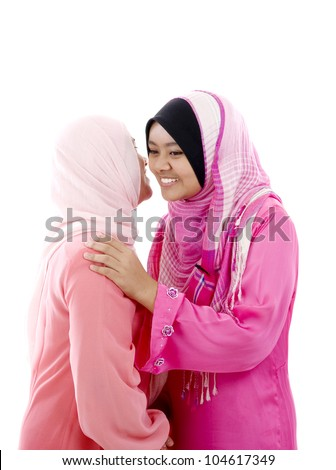 muslim women hugging - stock photo