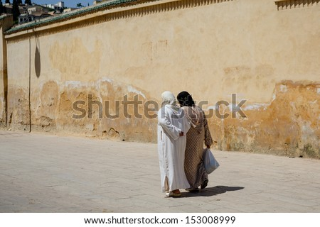 Muslim women on the street of Fes, Morocco - stock photo