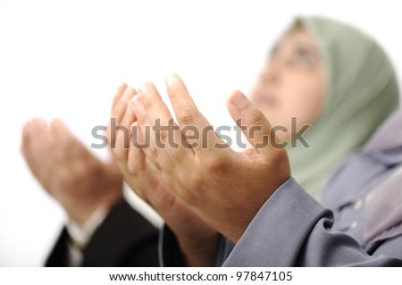 Muslim women praying together - stock photo