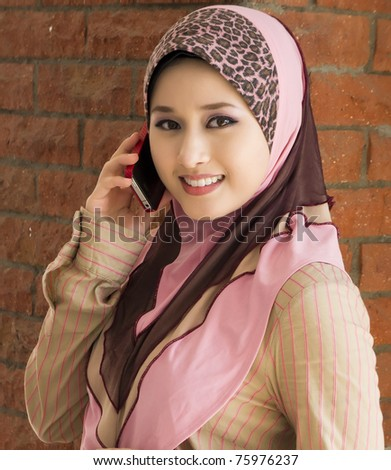 muslim young girl make a phone call