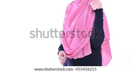 Muslimah girl with pink hijab view. copyspace area - stock photo