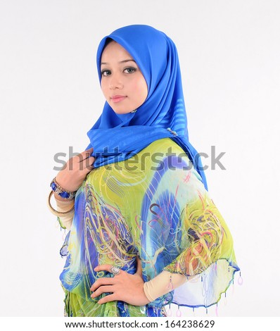 Muslimah lady pose in blue hijab - stock photo