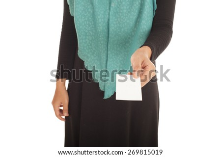 Muslimah woman holding a business card.