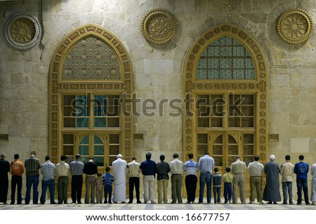 Muslims say prayers in old mosque in Damascus, Syria, first position #1 - stock photo