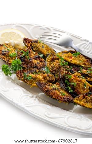 mussel au gratin on dish - stock photo