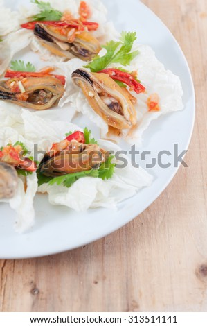 Mussel Salad.Selective focus. Very shallow Depth of Field, for soft background.