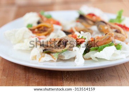 Mussel Salad.Selective focus. Very shallow Depth of Field, for soft background. - stock photo