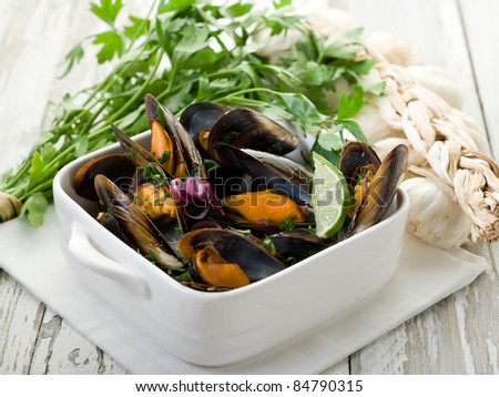 mussel soup on bowl with parsley and garlic - stock photo