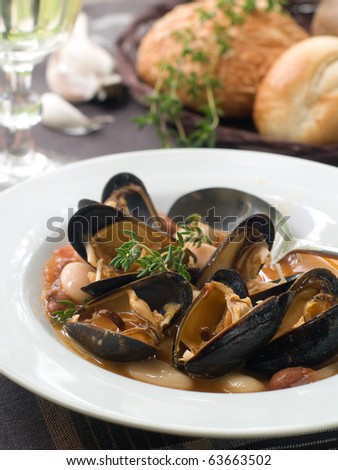 mussel soup on bowl with white wine - stock photo