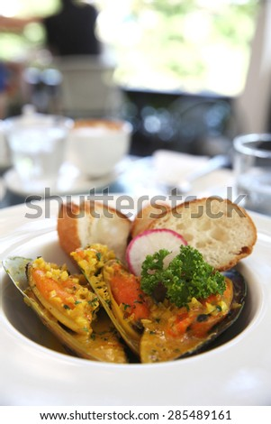 mussel with cream sauce - stock photo