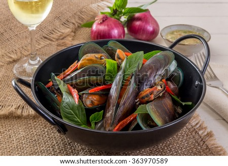 Mussels baked basil - stock photo
