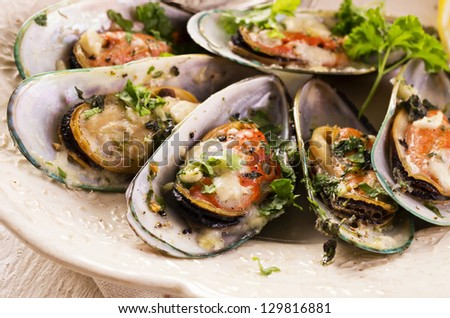 mussels baked with parmesan and herbs - stock photo
