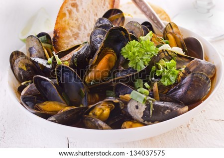 mussels cooked in red sauce - stock photo