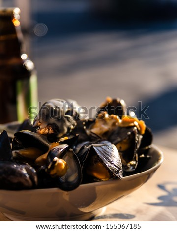 Mussels in the bowl in a white wine sauce. in the street cafe.  - stock photo
