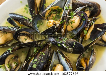 Mussels marinara - stock photo