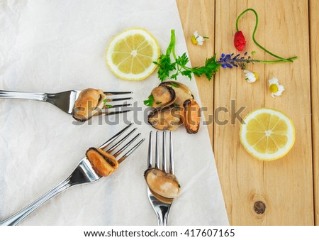 Mussels salad with parsley and lemon. - stock photo