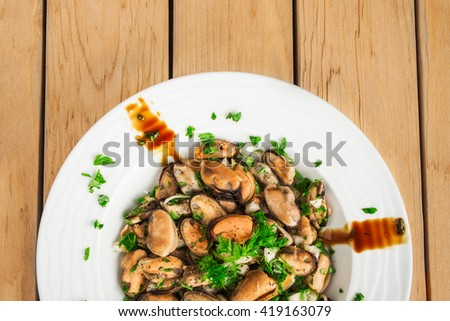 Mussels salad with parsley and onion. Close up image. - stock photo