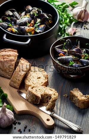 Mussels served with bread - stock photo