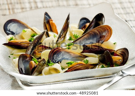 mussels soup with pasta orecchiette