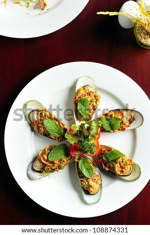 Mussels white plate - stock photo
