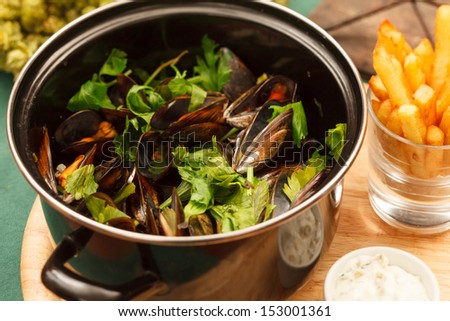 mussels with french fries  - stock photo