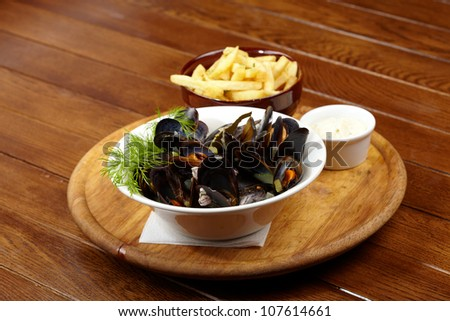 mussels with sauce - stock photo