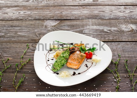 Mussle, grilled salmon, shrimp on wood copyspace. White plate with variety of seafood on wooden background. Free space and seafood mix plate. - stock photo