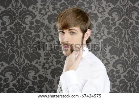 mustache retro businessman funny gesture hand on vintage wallpaper - stock photo