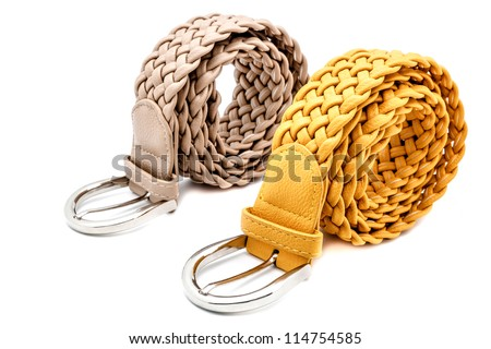 Mustard and grey women belts on a white background - stock photo