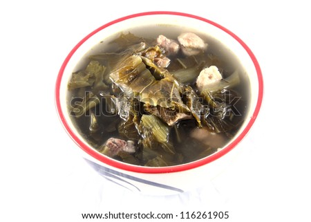 mustard green pickled with pock soup - stock photo