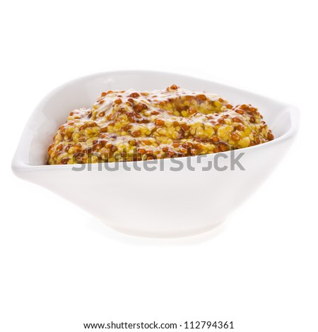 Mustard in a white bowl closeup isolated on white background - stock photo