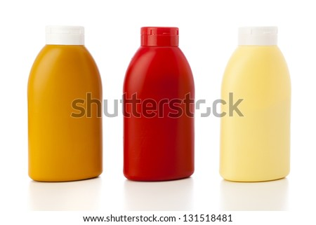 mustard, ketchup and mayonnaise in plastic bottles isolated on white - stock photo