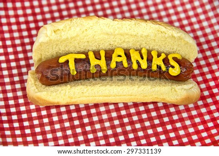 mustard on grilled hot dog in a bun for thank you - stock photo