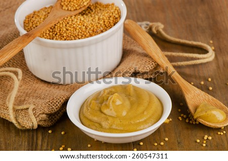 Mustard  on   wooden background. Selective focus - stock photo