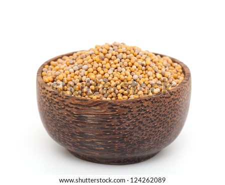 mustard seeds in a wooden bowl - stock photo