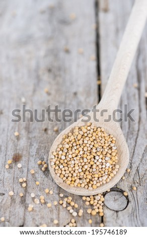 Mustard Seeds on a cooking Spoon (close-up shot) - stock photo